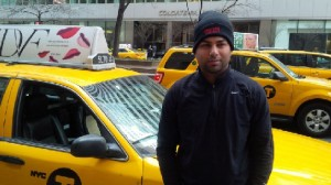 A New York City taxi driver sporting a Drivers Direct Beanie!