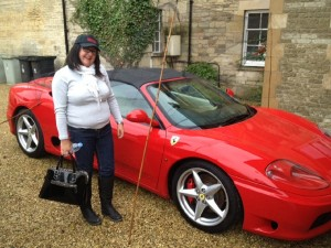 Vicky Meaden wearing her DDR cap with her friend's Ferrari in Stamford.