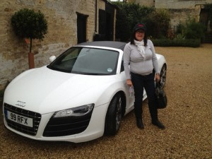 Vicky Meaden wearing a DDR cap next to her friend's Audi R8 in Stamford